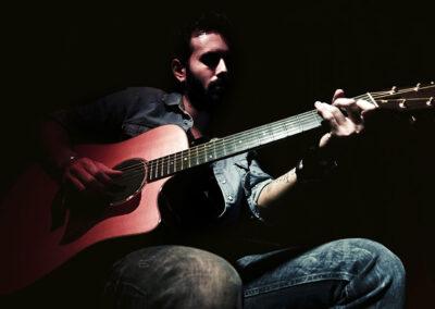 unai-iker-playing-acoustic-guitar